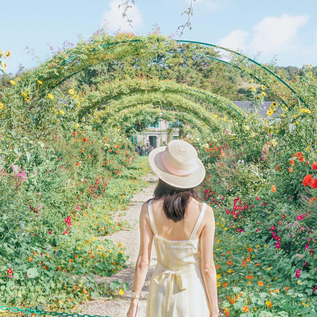 In front of Monet's Garden Flower Arch