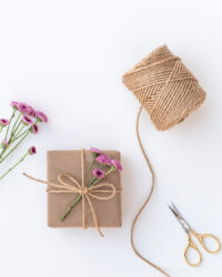 Gift wrapping with kraft paper and twine.