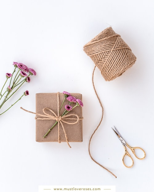 Gift wrapped with flowers and twine
