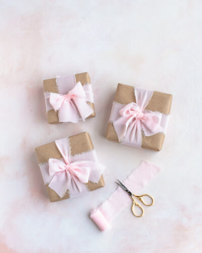 Presents wrapped with recyclable paper and reusable ribbon