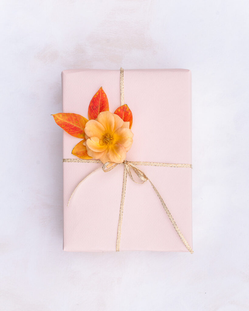 Gift wrapped with flower and leaves