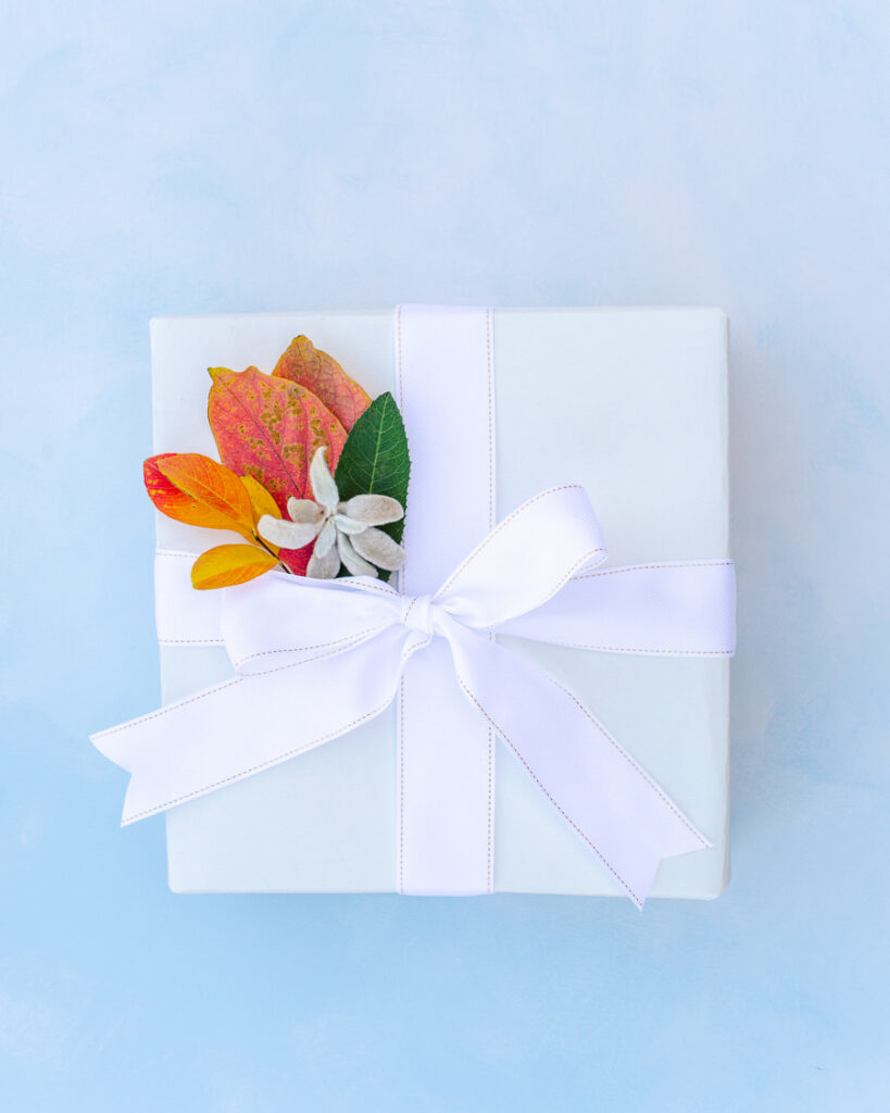 Gift wrapped with recyclable paper and decorated with colorful leaves