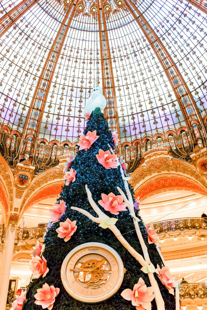 Christmas tree and decorations inside Galeries Lafayette in Paris