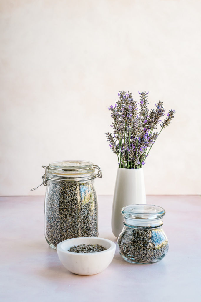Dried lavender buds stored in jars - How to Harvest and Dry Lavender