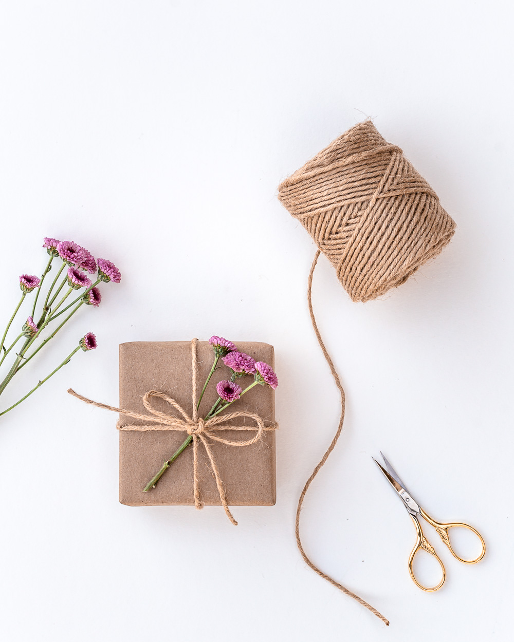 Eco-friendly gift wrapping with twine and flowers
