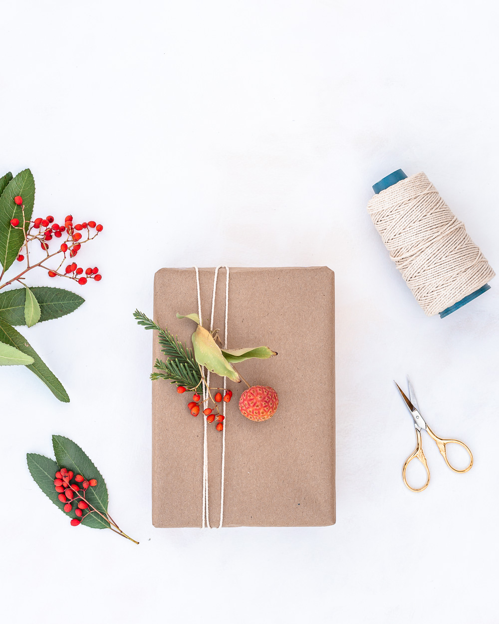 Eco-friendly gift wrapping with craft paper, twine and berries