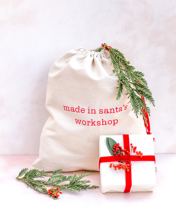 Eco friendly Christmas gift wrapping with recyclable craft paper, reusable Santa bag