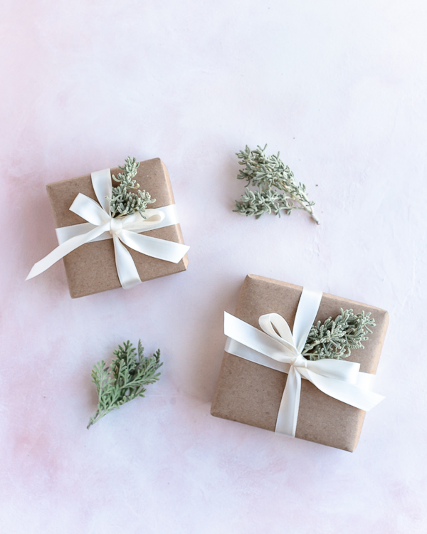 Eco Friendly sustainable gift wrapping with ribbon and leaf