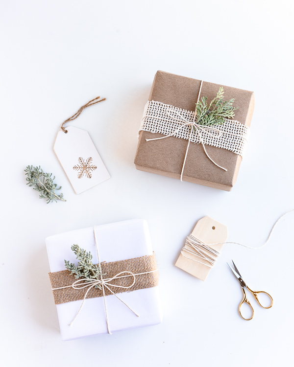 Eco friendly Christmas gift wrapping with recyclable craft paper, fabric and leaves