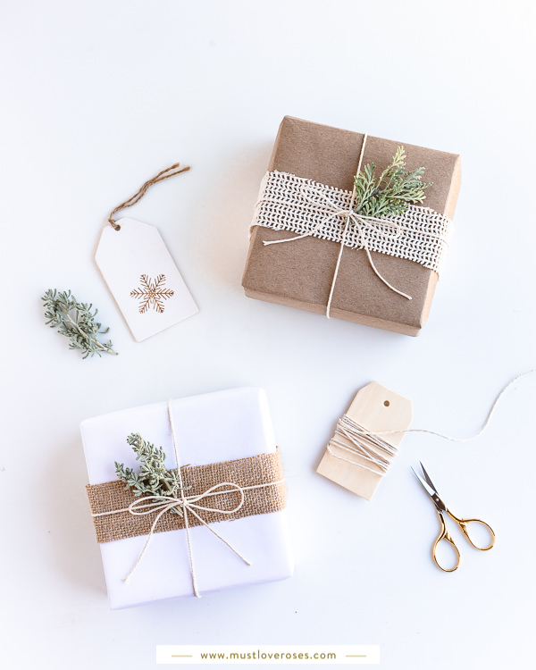 Gifts wrapped with eco-friendly kraft paper, twine and leaves