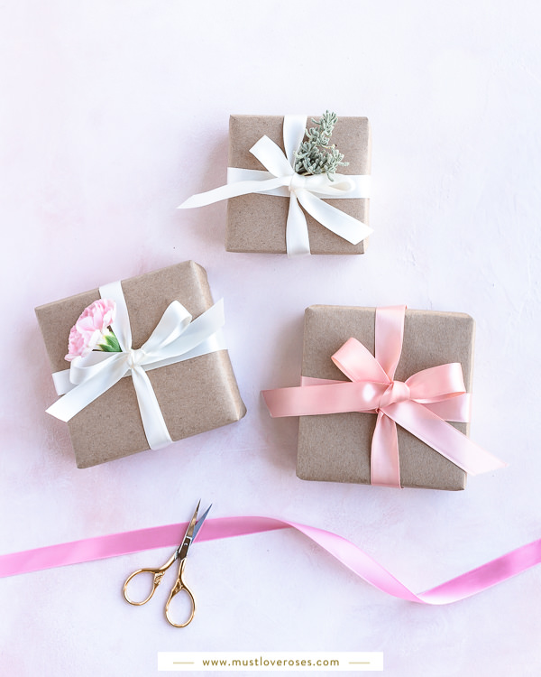 Gifts wrapped with eco-friendly kraft paper, ribbons and flowers